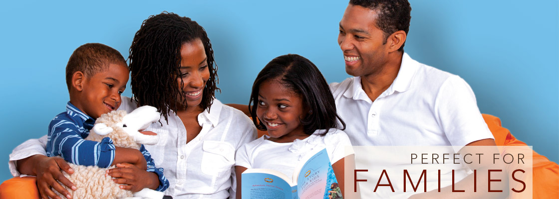 A young girl reading The Story for Kids to her mother, father, and younger brother